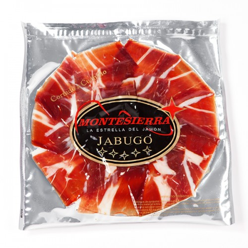 Slices of Acorn fed Iberian Ham Jabugo carved with a knife